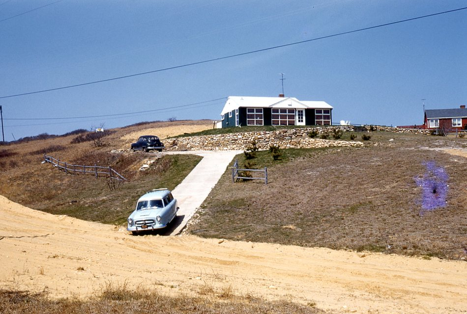 Our house in Montauk with our Nash Rambler Station Wagon exiting the driveway.