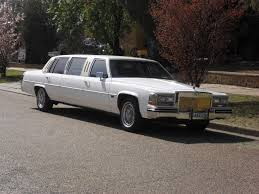 After a minute or two, the longest super-stretch Cadillac Limousine imaginable turned the corner, and slowly glided toward the curb.