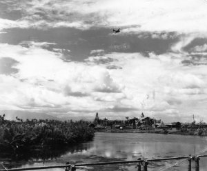 A C46 in the sky over New Guinea. Probably bringing photographs in the mail of little Shaun.