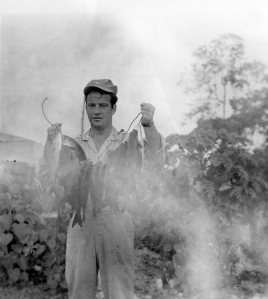 FISH FOR DINNER - Lt. Al shows off his catch. Papua New Guinea 1944