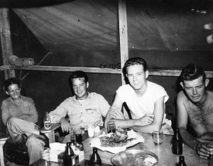 Lt. Al knocking back a few cold ones with his Signal Corps buddies. Papua New Guinea 1944