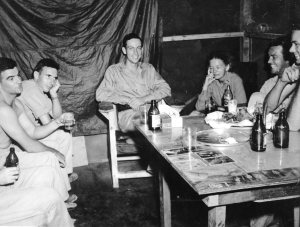 BEER DELIVERY MAKES FOR HAPPY SOLDIERS. Lt. Al and his signal Corps buddies enjoying a few.