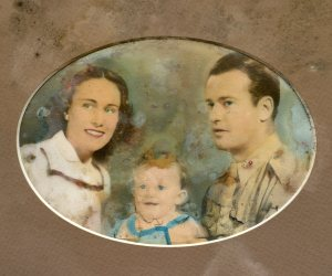 The boys in the Pacific carried family pics with them. Lt. Al was no exception. Yep, that's me in the middle.