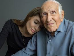 Director Angelina Jolie shown here with the real Louie Zamperini shortly before his death.