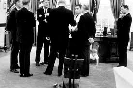 Kennedy and some of his senior staff were standing there, in the Oval Office.